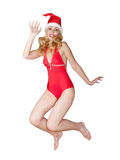 Portrait of the young slender blonde to red cap of Santa Claus on a white background Stock Photo