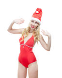 Portrait in the young slender woman full growth in red clothes  and a red cap of Santa Claus Stock Photos