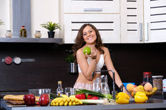 Portrait of a young slim woman in lingerie in the kitchen Stock Photo