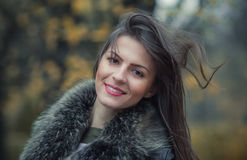 Portrait of a young smile woman wearing fur Stock Image
