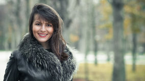 Portrait of a young smile woman wearing fur Stock Images