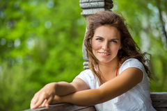 Portrait of young smilin woman in the summer park Royalty Free Stock Image