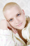 Portrait of young smiling bald blond woman Stock Images