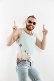 Portrait of young smiling bearded man in sunglasses showing thumbs up. Against of white background. Isolated Royalty Free Stock Photo