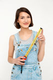 Portrait of young smiling beautiful girl, holding tape measure Royalty Free Stock Images