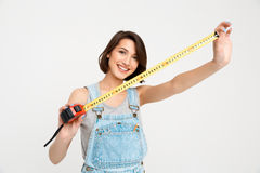 Portrait of young smiling beautiful girl, holding tape measure Royalty Free Stock Photo