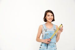 Portrait of young smiling beautiful girl, holding tape measure Stock Images