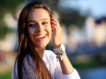 Portrait Of Young Smiling Beautiful Woman. Close-up portrait of a fresh and beautiful young fashion model posing outdoor Stock Image