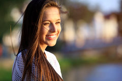 Portrait Of Young Smiling Beautiful Woman. Close-up portrait of a fresh and beautiful young fashion model posing outdoor Royalty Free Stock Photos