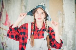 Portrait of young beautiful woman in newspaper hat. Repair home concept. Royalty Free Stock Image