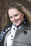 Portrait of Young Smiling Blond Fashionable Female Posing Outdoors Royalty Free Stock Images
