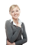 Portrait of young smiling blond girl. In gray blouse isolated on white royalty free stock images