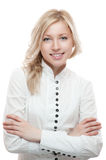 Portrait of young smiling blond girl. In white blouse isolated on white stock photo