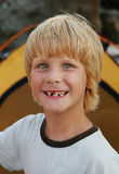 Portrait of young smiling boy. Close up portrait of happy young boy with smile on his face on tent background Royalty Free Stock Photography