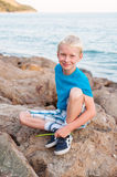 Portrait of young smiling boy at the sea Stock Images