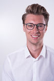 Portrait of a young smiling business man in white shirt royalty free stock images