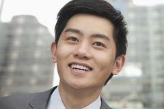 Portrait of young smiling businessman, close-up, outdoors in Beijing Stock Photography