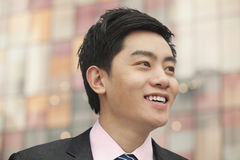 Portrait of young smiling businessman, close-up, outdoors in Beijing Royalty Free Stock Photo