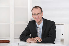Portrait of a young smiling businessman or engineer with glasses. Manager or engineer with glasses in suit and tie Royalty Free Stock Photo