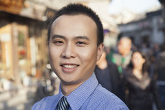 Portrait of young smiling businessman in Houhai, Beijing, China Stock Photo
