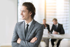 Portrait of a young smiling businessman. Portrait of young smiling businessman launched first effective business, setting himself up for successful career stock images