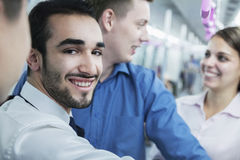 Portrait of young smiling businessman standing on the subway, looking at camera Royalty Free Stock Photography