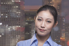 Portrait of young smiling businesswoman, cityscape of Beijing in background Royalty Free Stock Images