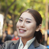 Portrait of young smiling businesswoman in Houhai, Beijing, China royalty free stock images