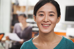 Portrait of young smiling businesswoman in the office Stock Images