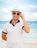 Portrait of young smiling Caucasian man on the coast Stock Images