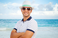 Portrait of young smiling Caucasian man on sea coast Stock Photo