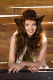 Portrait of young smiling cowgirl in stetson Stock Image