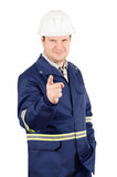 Portrait of young smiling engineer pointing to the camera. Portrait of young smiling engineer in overalls and helmet pointing to the camera isolated on white Stock Image