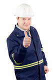Portrait of young smiling engineer with a thumbs up. Portrait of young smiling engineer in overalls and helmet with a thumbs up isolated on white background Royalty Free Stock Photography