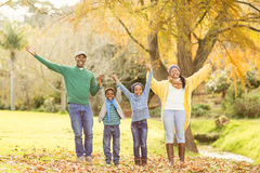 Portrait of a young smiling family with arms raised Royalty Free Stock Photography