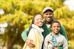 Portrait of a young smiling family. On an autumns day royalty free stock photography