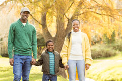 Portrait of a young smiling family. On an autumns day royalty free stock photos