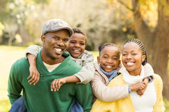 Portrait of a young smiling family in piggyback. On an autumns day royalty free stock photos