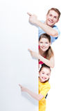 Portrait of young smiling family pointing. stock photography