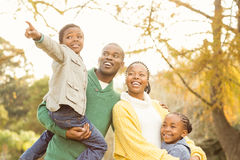 Portrait of a young smiling family pointing something Stock Image