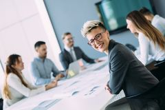 Portrait of young female architect on meeting Stock Image