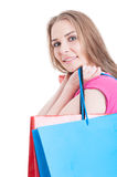 Portrait of young smiling female holding shopping or present bag Royalty Free Stock Photo