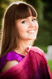 Portrait of young smiling girl with bordeaux shawl Royalty Free Stock Photography