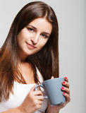 Portrait of a young smiling girl with cup of tea Royalty Free Stock Image