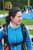 Portrait of the young smiling girl-parachutist Stock Image
