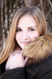 Portrait of Young smiling girl in winter park Stock Photo