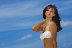 Portrait of young smiling happy woman in white bikini on Royalty Free Stock Photography