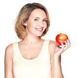 Portrait of a young smiling healthy woman with apple Stock Photography