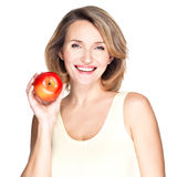 Portrait of a young smiling healthy woman with apple Royalty Free Stock Photo