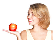Portrait of a young smiling healthy woman with apple Royalty Free Stock Photos